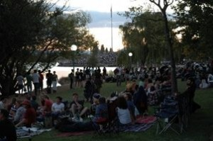 Picnickers enjoy the wait at the edge of the lake