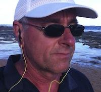 chris edwards jogging on beach